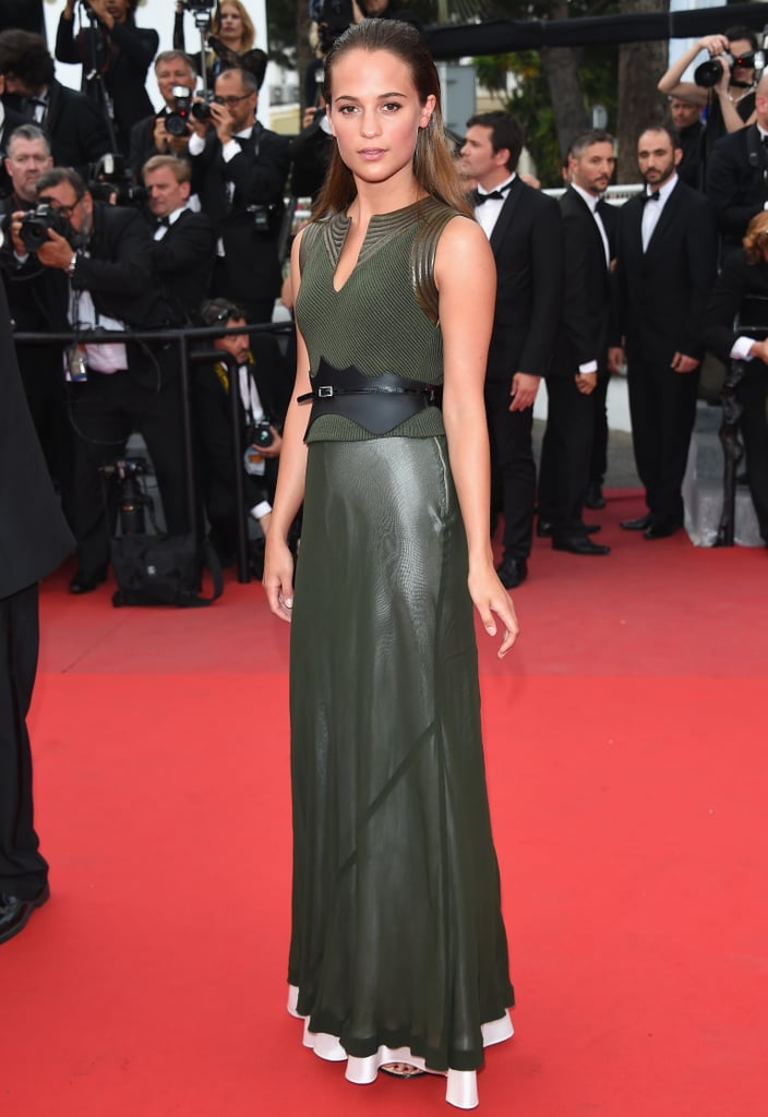 """Vikander wearing Louis Vuitton at the Cannes Film Festival. If there's any further evidence needed that Vikander is on the verge of something huge, it's her new deal with Louis Vuitton. It's a truism that any actress with a hint of buzz — not to mention beauty — sooner or later lands a fashion contract. And Vikander has succeeded, again, in this area; she was recently photographed on the red carpet at the Cannes Film Festival wearing a handful of looks from Louis Vuitton after being named as one of the company's new brand ambassadors. Between fashion, films, and Fassbender, the next months will clearly be busy for Vikander. Her hectic schedule makes the rare day off, when Vikander likes to see friends and cook, even more precious. She specializes in dishes that are good for sharing, like moussaka and chili.    A day at home may be wonderful, but restless Vikander is ready for whatever is next. """"I tell myself to do nothing,"""" she explained, """"and then that day comes. Then, I had a few days off and suddenly, I go somewhere. I have a list of places that I still want to see, places I want to go. I'd say whatever I plan is probably not what I end up doing."""""""