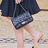 She also popularised her eponymous two-toned shoes and gold-chained handbags.