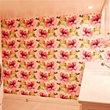 Even the laundry room is full of Lauren's signature touches, like the girlie statement wallpaper.