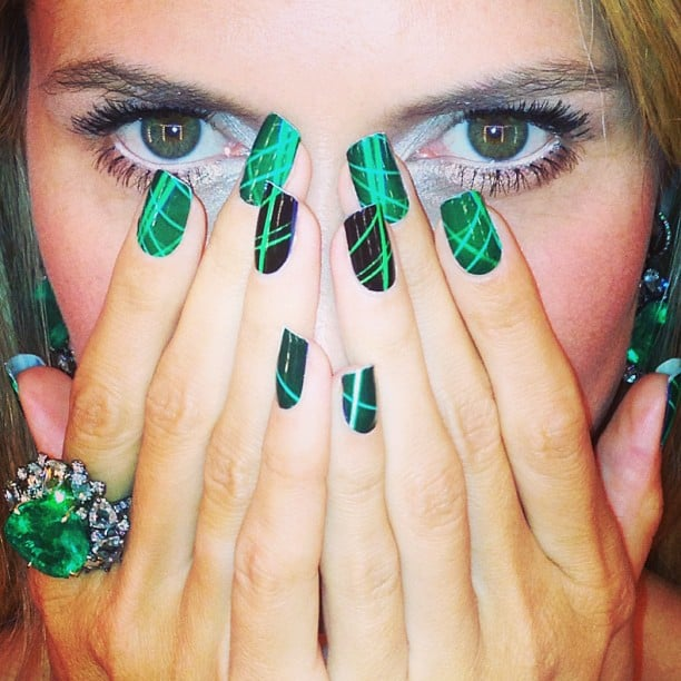 If you can get past staring at that gorgeous emerald stone by Lorraine Schwartz, you might notice Heidi's coordinating, geometric nails.  Source: Instagram user heidiklum