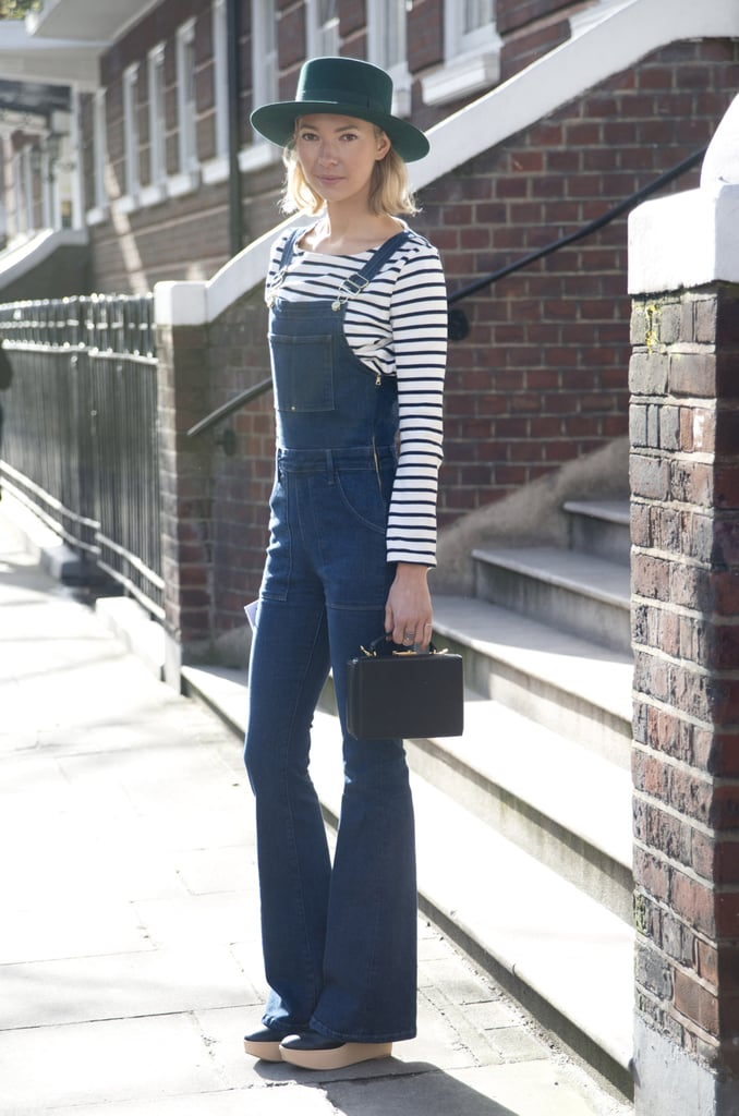 Flared dungarees with a striped top and statement accessories