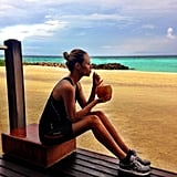 Natasha Poly enjoyed a fresh drink on the beach. Source: Instagram user natashapoly