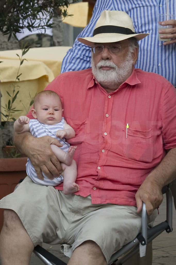 Francis Ford Coppola held an infant.