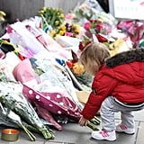 A little girl stopped by the memorial outside the South Africa House in London.
