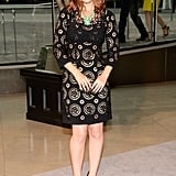 Kate Mara accessorized her elegant black Dolce & Gabbana minidress with a bold green Irene Neuwirth necklace and Brian Atwood pumps.