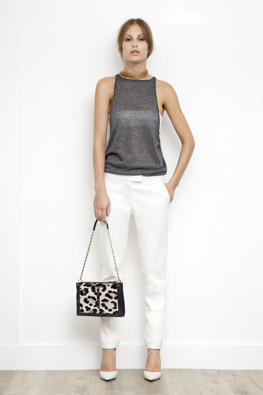 Lurex Low Side, High Neck Tank in Silver, Leather Bandeau in Cream, Slim Pant in Cream Wool, Addiction Nappa Pump in Cream, Attraction Pony Shoulder Bag in Grey/Cream Leopard. Photo courtesy of Tamara Mellon