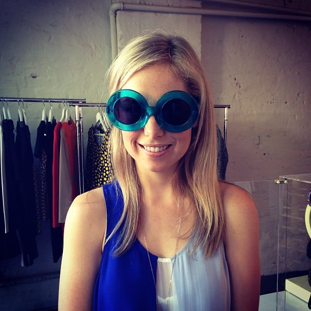 Buggin' out! Ali tried on a pair of major Karen Walker sunnies. . . Imagine the case they'd come in!
