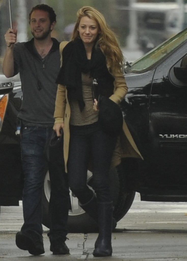 Blake Lively had help with her umbrella as she arrived on the NYC set of Gossip Girl yesterday. She carried a Chanel iPad case, her hat, and a cell phone in her left hand, but her wedding ring was still slightly visible on her ring finger. Blake and Ryan Reynolds tied the knot earlier this month, and after enjoying a brief honeymoon in Virginia, she got right back to work. Her castmates threw a party to celebrate the surprise nuptials, which some speculated were because Blake is pregnant, though those reports were quickly denied by Blake's rep. While Blake films the final season of her hit show, Ryan has been spotted visiting a gym near the couple's home in New York.