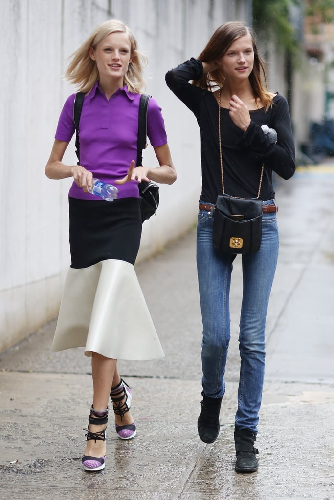 A model moment — one in statement-making hues and silhouettes, the other played it cool in basics. Source: Greg Kessler