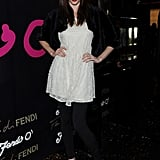 Coco Rocha showed off a new heavier fringe at the Fendi O party. She wore a fur bolero over a white dress.