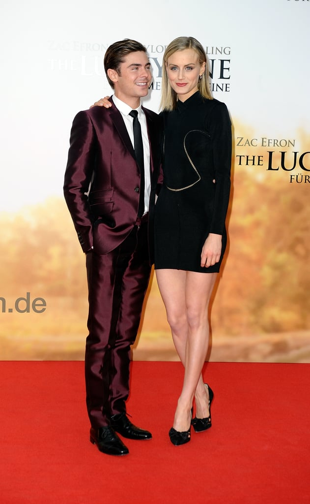 Zac Efron stepped out in a sophisticated George Clinton suit for the Berlin premiere of The Lucky One yesterday. He was joined by his costar Taylor Schilling, who walked the red carpet alongside him in a black Alaia dress. Zac also sported a bandage on his left hand. Zac injured his hand, and joked earlier this week that the wound was a result of being bitten by an overzealous fan. Zac and Taylor are already enjoying success with The Lucky One, which opened in the number two spot over the weekend, and have been making appearances at the film's many European premieres. Zac will soon wrap up this round of press duties, but he'll be back at it again later this year when his next movie The Paperboy hits theaters.