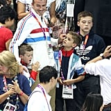 David, Cruz, Romeo, and Brooklyn Beckham watched the action at the Olympic Aquatics Centre in London over the Summer.