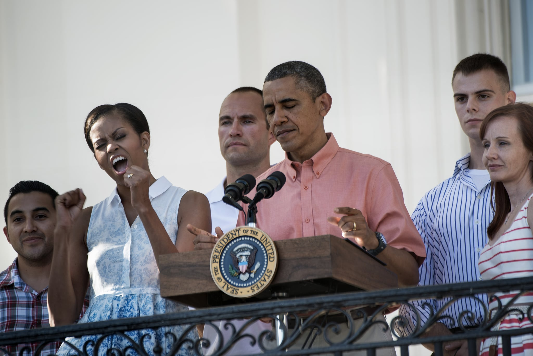 Michelle Obama cheered while President Obama addressed members of the military and their families at the 2013 White House BBQ.