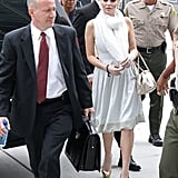 Lindsay Lohan was ushered into a courthouse.