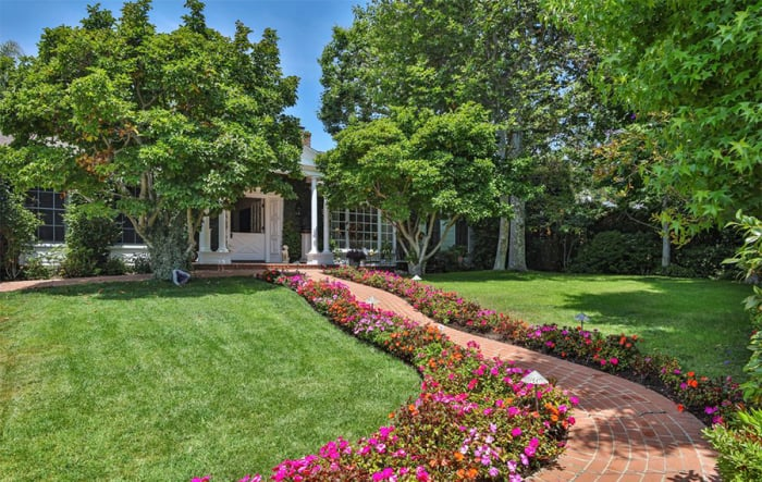 """Famously unwed actors Goldie Hawn and Kurt Russell have found the secret to staying together long-term — but that doesn't mean they're committed to staying in their house forever. The couple listed their very private and very homey Pacific Palisades mansion for $9.4 million in Fall 2016 and Variety is exclusively reporting that they just sold it for $8.9 million. While it went a bit below asking, the A-listers still made money on the deal since they purchased the property in 2004 for just over $5 million before they, according to the listing, """"thoughtfully"""" renovated it in 2006.  The 593-square-metre property has five bedrooms, including a double-level guest suite with soaring vaulted ceilings, and five bathrooms, so there's plenty of room for their adorable family to spend the night. When the talented brood isn't hanging out in the sun-drenched living room, cosying up in the spacious master suite — it has its own en suite fireplace, spa tub, and dry sauna — or cooking in the sprawling central kitchen, they can stay busy enjoying the pool and lush grounds outside. The house is filled with spectacular skylights and hardwood floors, and the decor is a blend of worldly bohemian and shabby-chic, California cool. While the vibe is very low-key and welcoming, unique elements — such as a meditation room and fully equipped fitness studio — are reminders of the home's movie star owners."""