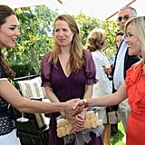 Kate Middleton meets Reese Witherspoon at the Tusk Trust reception in Beverly Hills.