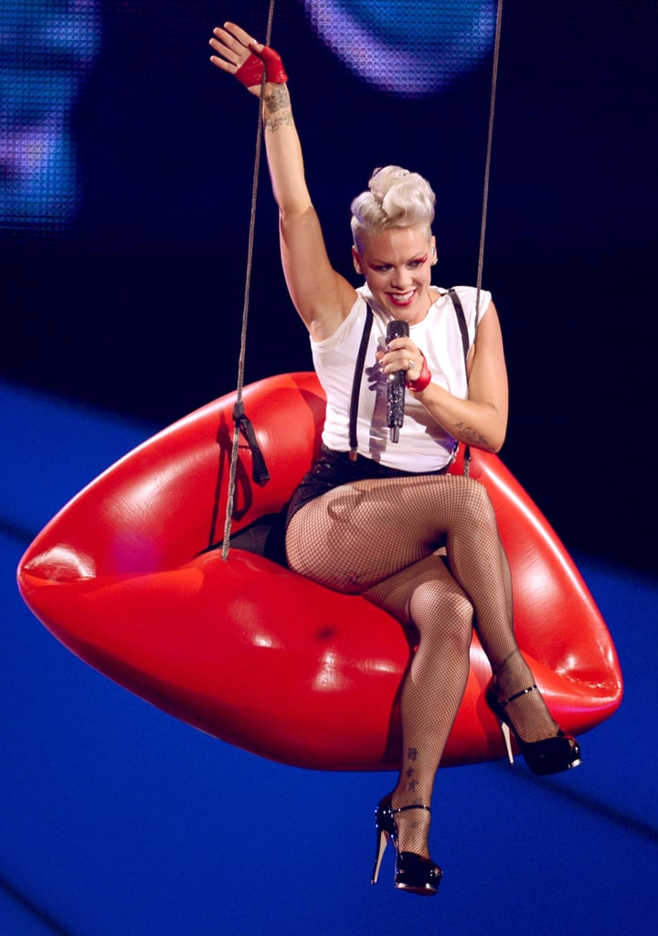 Pink rode into her performance on a pair of lips.