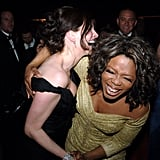 Julia laughed with Oprah Winfrey at the 2005 Academy Awards Governors Ball.