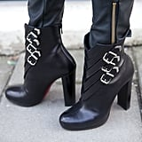 Buckle detailing on these Christian Louboutin ankle boots lent a tough touch to this street-style look.