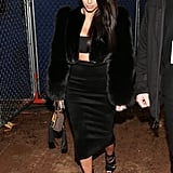 Kim Wore a Bandeau Crop Top and Midi Skirt to a Super Bowl Party