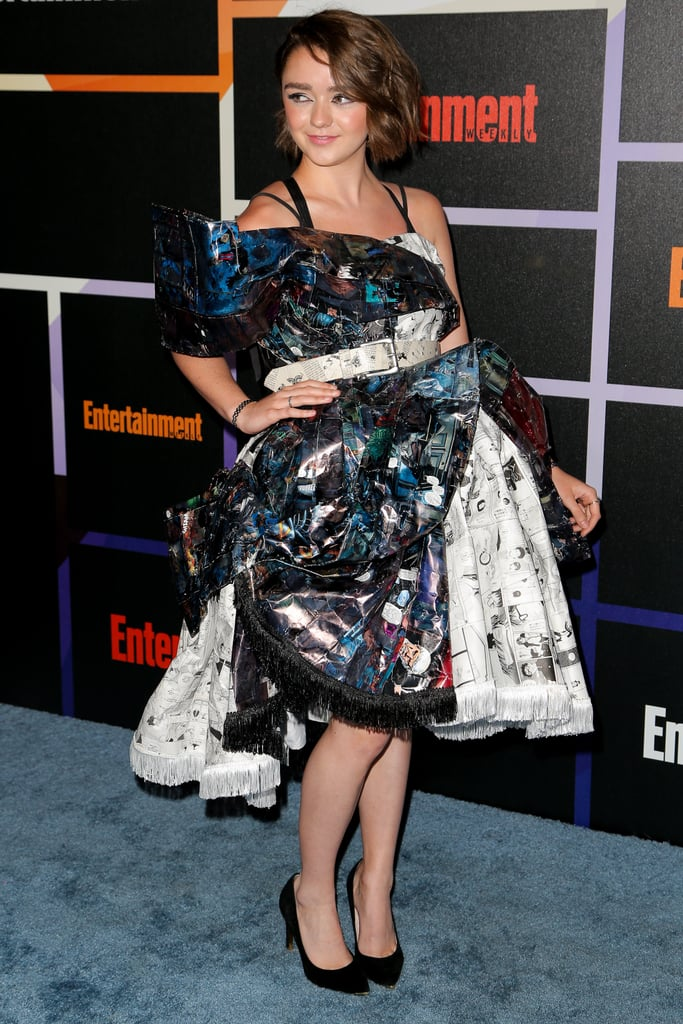 Maisie definitely knows how to be event appropriate! Her dramatic dress for a Comic-Con appearance was made entirely from recycled graphic novels by Ryan Jude Novelline. The belt was made from an old copy of a Game of Thrones novel.