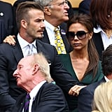 Victoria Beckham put her arm around David as they watched a game at Wimbledon.