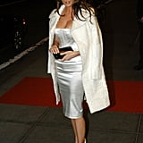 Melania tended to pair tight-fitting minidresses with voluminous, textured coats, just as she did here for Usher's 26th birthday party in 2004.