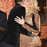 Inside the venue, Kim embraced the designer, Olivier Rousteing.