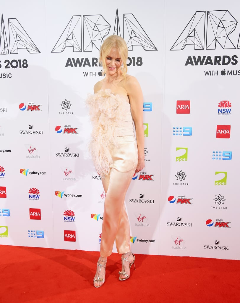 By looking at pictures, we think it's safe to assume Nicole Kidman was feeling her fun and flirty outfit at the 2018 ARIA Music Awards. The actress attended the Sydney, Australia award show to support her husband Keith Urban, who was hosting. Nicole hit the red carpet in an ethereal feathered blouse and silk pants from Oscar de la Renta's recent Spring 2019 collection. She accessorized the look with metallic gold heels, a printed box clutch, and the right amount of diamonds. Ahead, see pictures from her elegant red carpet appearance and shop an array of different feathery looks.      Related:                                                                                                           Nicole Kidman's Most Memorable Red Carpet Moments Will Remind You of Grace Kelly