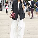 Leandra Medine showed off an armful of jewels and an elegant white and black look.