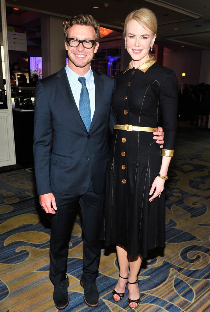 Nicole Kidman wrapped her arm around Simon Baker during the evening.