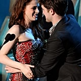 Robert Pattinson and Kristen Stewart shared a squeeze on stage during the MTV Movie Awards in 2011.