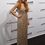 Lindsay Lohan wore a beaded gown at the amfAR gala in NYC.