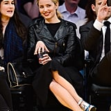 You can take the lady courtside, but you can't take the lady out of her. No t-shirt here: Dianna Agron caught a Lakers game in a chic black motorcycle jacket and metallic heels.