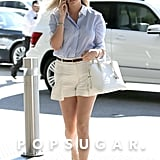 Kate completed her Target and Louis Vuitton pieces with neutral essentials: a skinny brown woven belt, cream loafers, a crocodile satchel, Ray-Ban sunglasses, and a silver watch.