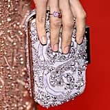 Petra Nemcova carried a beaded white clutch.