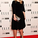 Sarah Burton kept it simple in an understated black frock — but styled up the look with statement add-ons.