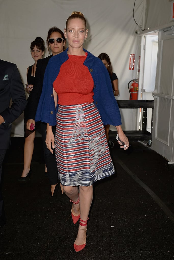 Uma Thurman made a colorful statement when she arrived at the Carolina Herrera show on Monday.
