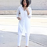 With an Oversize White Button-Down, Snakeskin Heels, and a Wide-Brim Hat