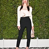 Alessandra Ambrosio teamed a relaxed blouse with high-waisted trousers at Chloé's VIP runway show.