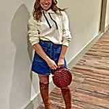 I love the ivory hoodie styled with a denim skirt, a mod, circular bag, and suede boots.