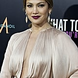 Jennifer Lopez accessorized her disco-inspired dress and moody lipstick with double cocktail rings.