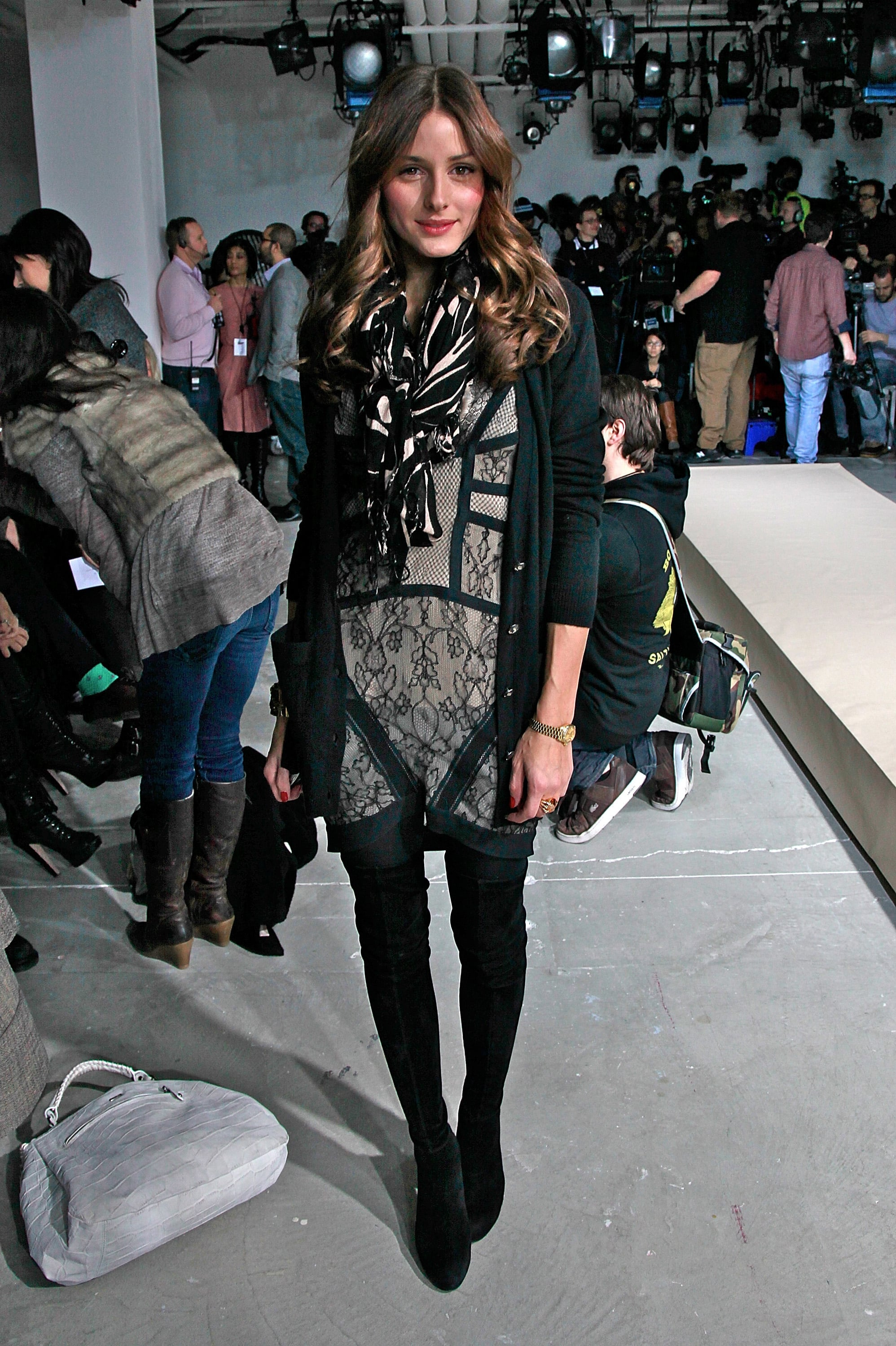 Layering up a Preen lace dress at Fashion Week in February 2010.