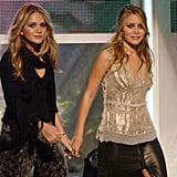 16-year-old sisters Mary-Kate and Ashley Olsen presented together in 2002.