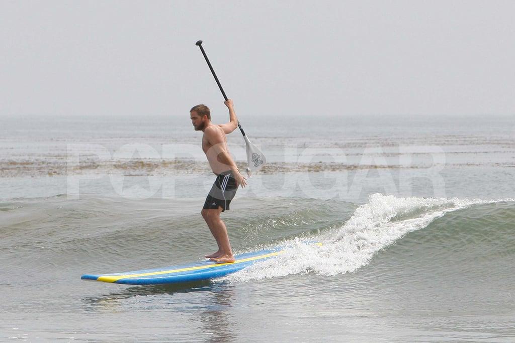 Robert Pattinson was shirtless in the ocean.