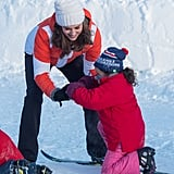 Kate graciously helped a little girl who fell during a ski lesson in Oslo, Norway in February 2018.