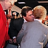 Rick Perry kisses a 100-year-old woman on the neck in Iowa.
