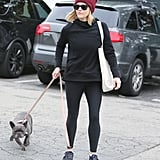 Reese loves to add a pop of color, like this sporty outfit paired with a red beanie.