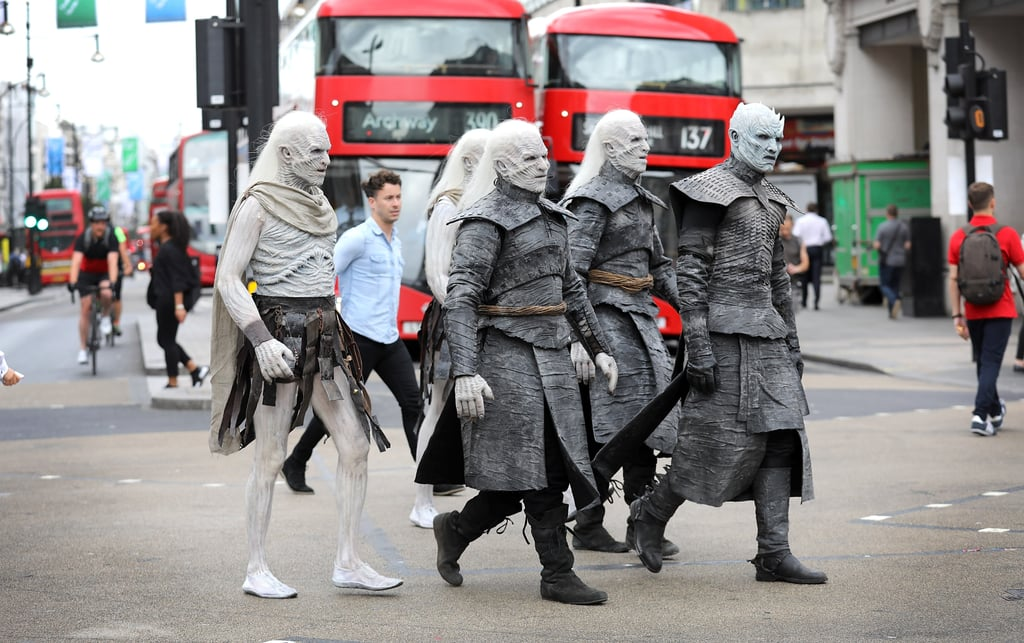 White Walkers: they want to destroy the Wall, all of humanity, and hey, just take a leisurely vacation to London. The terrifying Game of Thrones characters took a break from horrifying Westeros on Wednesday morning to play tourists in the city. The Night's King and some of his frozen cronies rode around on horseback, popped by Tower Bridge, window-shopped at the Nike store, and even made sure to pay their respects to the queen, posing for a few group photos in front of Buckingham Palace.  With temperatures climbed into the 70s in London, we can't imagine how hot it must've been for the guys under all of those layers of prosthetics. Each actor endured four hours of makeup before setting out on the city to ensure they looked exactly like the icy Game of Thrones creatures, and it's safe to say they nailed it.  The show's seventh season might not premiere for another few days, but it sure looks like Winter is already here.