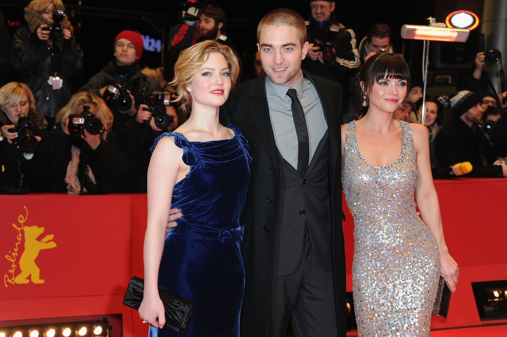 Rob flashed a smile as he posed between his two leading ladies.